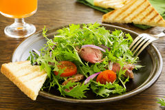 Roast beef salad with tomatoes Stock Image