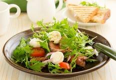 Roast beef salad with tomatoes Stock Image