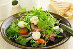 Roast beef salad with tomatoes Royalty Free Stock Photography