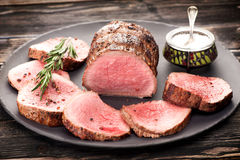 Roast beef with salt, pepper and rosemary Royalty Free Stock Photos