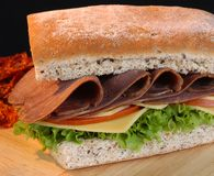 Roast beef sandwich. Roast beef sandwich with cheese and vegetables Royalty Free Stock Images