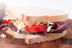 Roast beef sandwich with cheese and tomato and cole slaw. Sliced roast beef sandwich with cheese and tomato and cole slaw Stock Photo