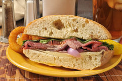 Roast beef sandwich. With onion rings and iced tea Stock Photo