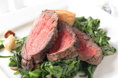 Roast beef  and sauteed spinach Stock Photography