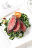 Roast beef and sauteed spinach Royalty Free Stock Images