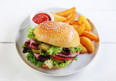 Roast beef sesame roll with French fries Stock Photography