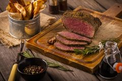 Roast beef with chips rustic Royalty Free Stock Images