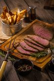 Roast beef with chips rustic Stock Image