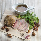 Roast beef. Sliced roast beef with some ingredients on the table of the kitchen Stock Photos