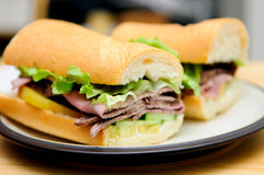 Roast beef sliced on a submarine roll with heirloom t. Deli style roast beef sliced on a submarine roll with heirloom tomato Stock Image