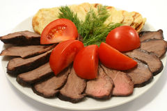 Roast beef slices and fried potatoes Royalty Free Stock Photography