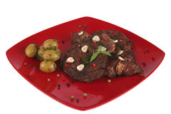 Roast beef slices on red dish Royalty Free Stock Photos