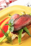 Roast beef with snow peas Stock Photos