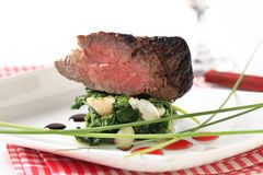 Roast beef and spinach leaves Stock Images