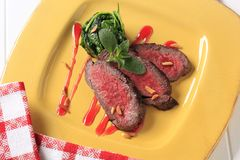 Roast beef and spinach leaves Royalty Free Stock Images