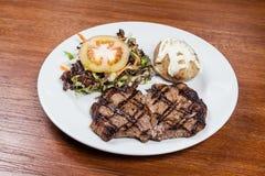 Roast beef steak with potato and salad Stock Photo