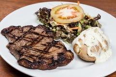 Roast beef steak with potato and salad Stock Image
