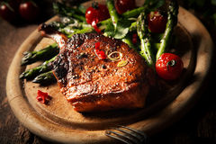 Roast Beef Steak on Wooden Round Cutting Board Royalty Free Stock Image