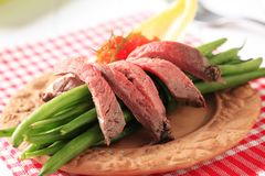 Roast beef  and string beans Royalty Free Stock Photos