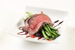 Roast beef and string beans. Slices of roast beef and string beans Stock Photography