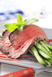 Roast beef with string beans Stock Photo