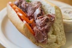 Roast Beef Sub Sandwich. Roast beef on torpedo roll with tomato basil and fresh mozzarella cheese Royalty Free Stock Photos