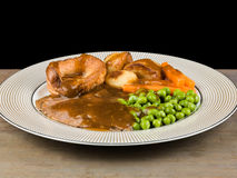 Roast Beef Sunday Lunch. Traditional Sunday Roast Lunch or Dinner of Roast Beef and Yorkshire Pudding Royalty Free Stock Images