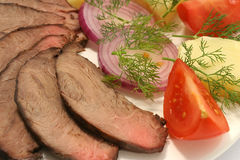 Roast beef with tomato and potato Stock Photo