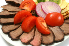 Roast beef tomato, potato, onion Royalty Free Stock Images