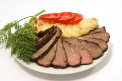 Roast beef and vegetables Stock Image