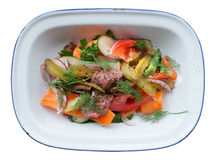 Roast beef and vegetables in enamel plate isolated on white Stock Photo