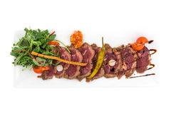 Roast beef with vegetables. Isolated on white background. Clipping path Royalty Free Stock Images