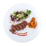 Roast beef with vegetables. Isolated on white background. Clipping path Royalty Free Stock Image