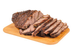 Roast beef on a wooden board Royalty Free Stock Photos