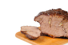 Roast beef on a wooden board stock images