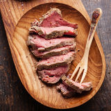Roast beef. And wooden fork royalty free stock photo