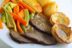 Roast beef, yorkshires and veg stock photos
