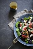 Roast beetroot, figs and feta salad. Autumn salad with roast beetroot, figs and feta cheese on the bed of green mixed salad leaves royalty free stock images