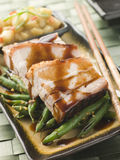 Roast Belly Pork with Fuji Apples and Peanut Beans stock photo