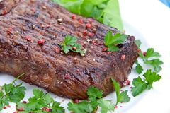 Roast big steak  on green dish close up Stock Photography