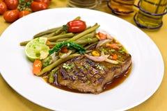 Roast big steak sirloin on green dish close up.  Stock Images