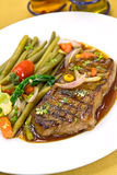 Roast big steak sirloin on green dish close up Royalty Free Stock Image
