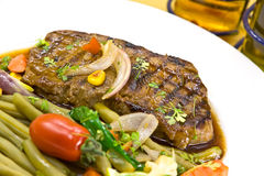 Roast big steak sirloin on green dish close up Royalty Free Stock Photography