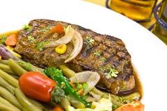 Roast big steak sirloin on green dish close up.  Royalty Free Stock Photography