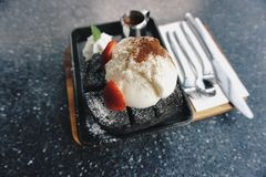Roast bread. Topping with vanilla ice cream and strawberry royalty free stock photo