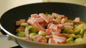 Roast brussels sprouts with ham stock video