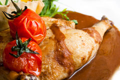 Roast chciken with red tomatos Stock Images