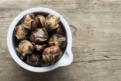 Roast chestnuts in a pot Royalty Free Stock Photos