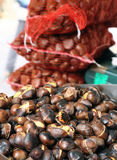 Roast chestnuts on sale in the local market stall Stock Image