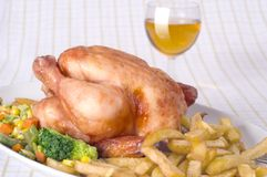 Roast chicken. With french fries and vegetables Royalty Free Stock Photos